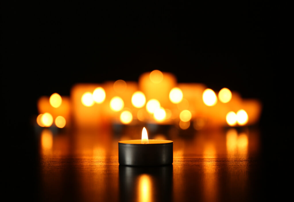 for memorial Burning candles on dark background
